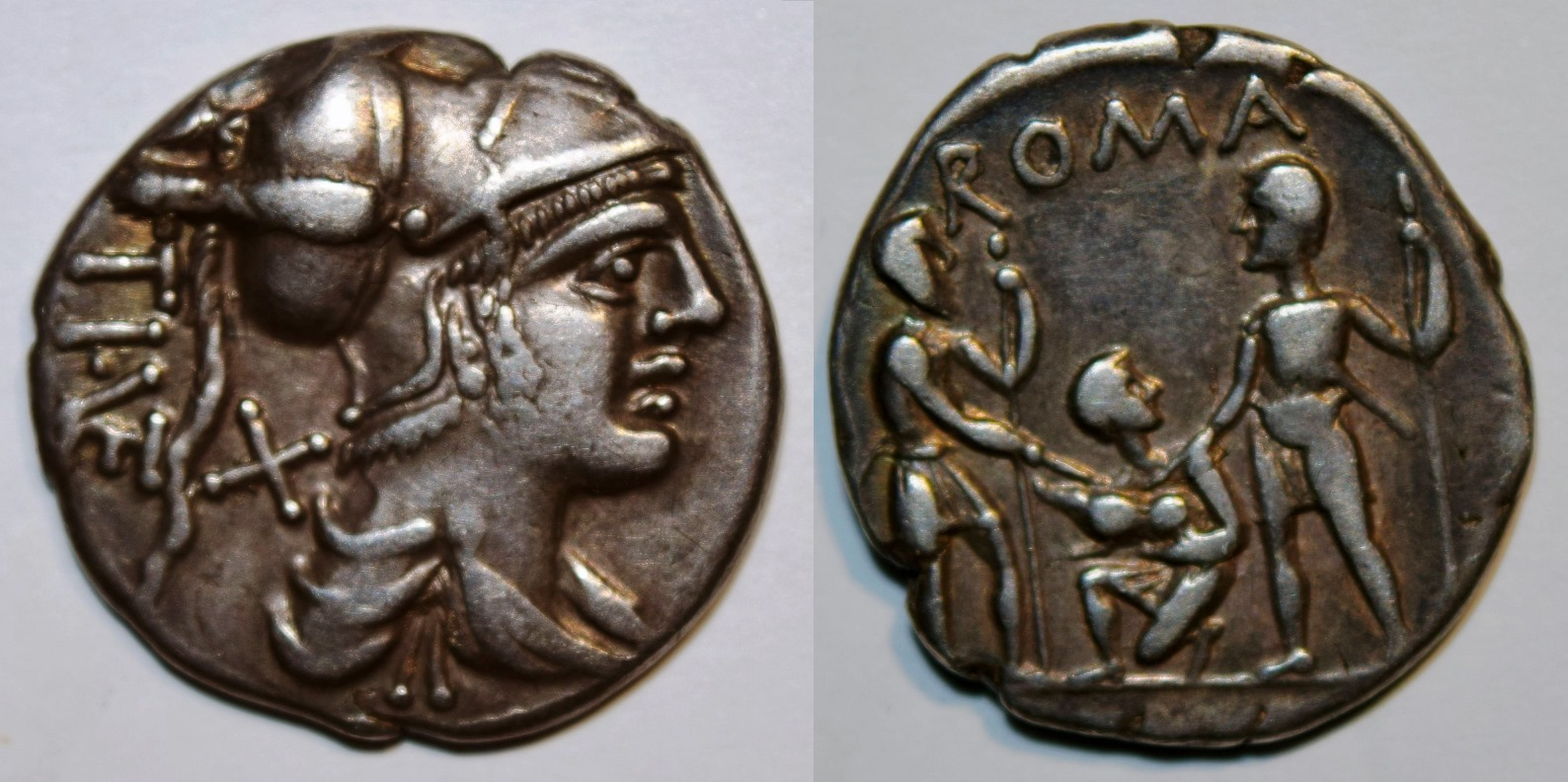Denarius of Ti. Veturius showing head of Mars and soldiers swearing an oath.