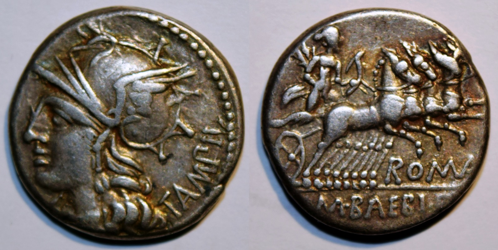 Denarius of M. Baebius Q.f. Tampilus with Head of Roma Left / Apollo in a Quadriga.